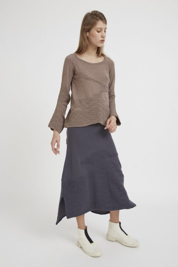 Inspired by the texture of the trees Loose fitting textured sweater, with asymmetrical embossed motifs to emulate tree bark. Featuring wide neckline and long sleeves, with extra volume in the elbows and wide cuffs. Made of 100% natural cotton, for the maximum quality and comfort.