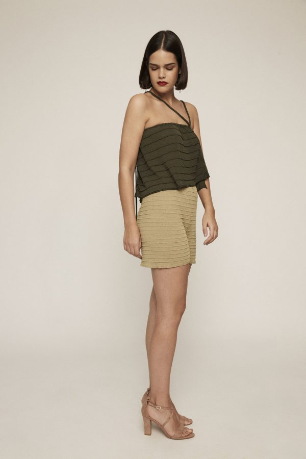 Deep green knit crop top. Featuring texture, braided details andstraps with strings.