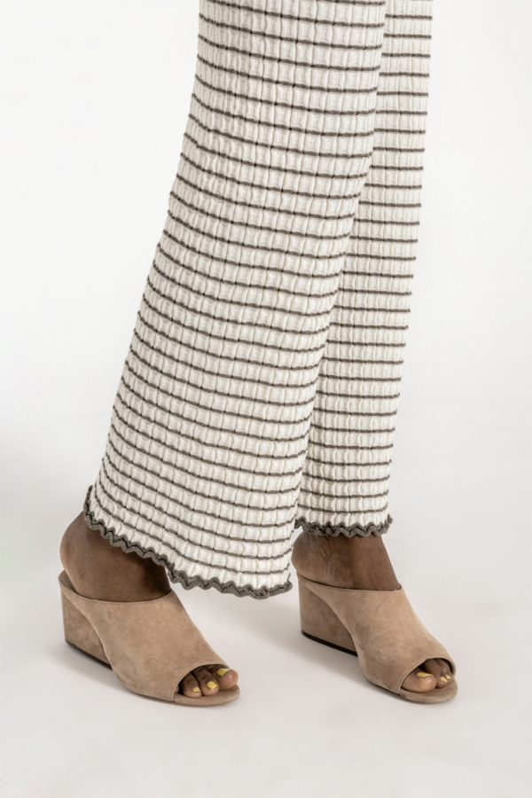 Wide leg textured knit pants, with elastic waist, contrasting stripes and ruffled extremes