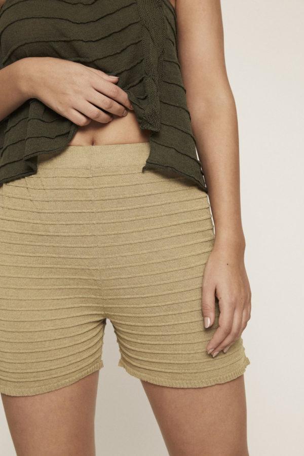 High waist khaki knit pants with texture and an elastic waist.